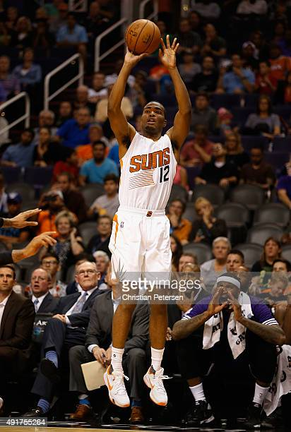 J Warren of the Phoenix Suns attempts a three point shot against the Sacramento Kings during the second half of the preseason NBA game at Talking...