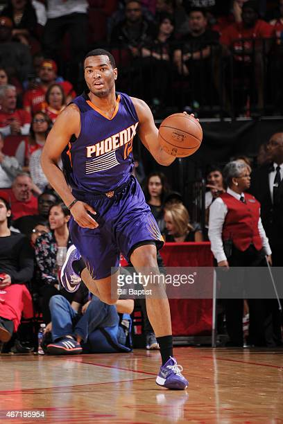 J Warren of the Phoenix Suns drives to the basket against the Houston Rockets during the game on March 21 2015 at Toyota Center in Houston Texas NOTE...