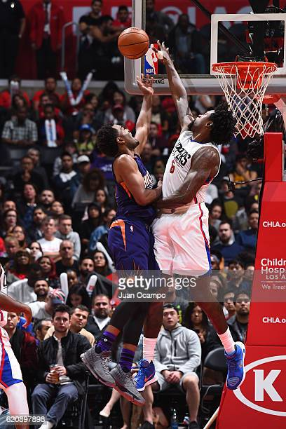 J Warren of the Phoenix Suns drives to the basket DeAndre Jordan of the LA Clippers on October 31 2016 at the STAPLES Center in Los Angeles...