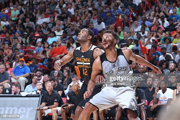 J Warren of the Phoenix Suns fights for position against Kyle Anderson of the San Antonio Spurs during the Las Vegas Summer League Championship on...
