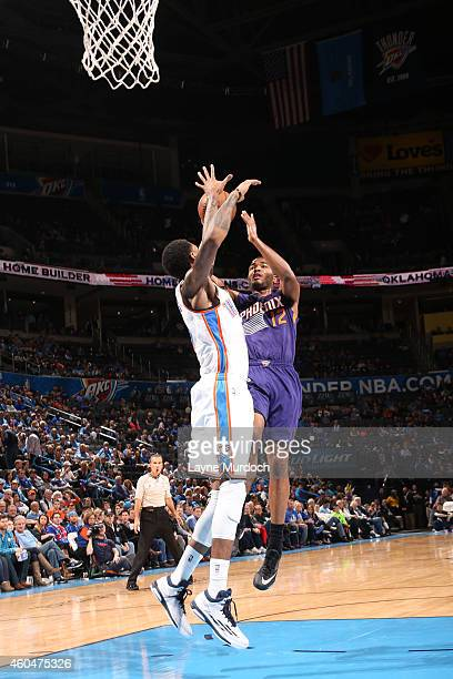J Warren of the Phoenix Suns goes up for a shot against the Oklahoma City Thunder on December 14 2014 at Chesapeake Energy Arena in Oklahoma City OK...