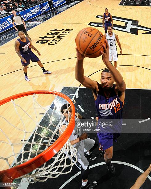 J Warren of the Phoenix Suns goes up for a shot against the San Antonio Spurs at the ATT Center on April 12 2014 in San Antonio Texas NOTE TO USER...
