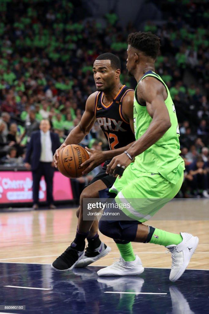 TJ Warren #12 of the Phoenix Suns handles the ball against the Minnesota Timberwolves on December 16, 2017 at Target Center in Minneapolis, Minnesota.