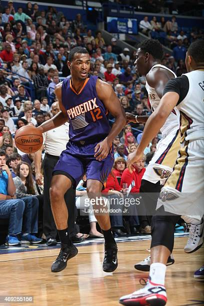 J Warren of the Phoenix Suns looks to move the ball against the New Orleans Pelicans during the game on April 10 2015 at Smoothie King Center in New...