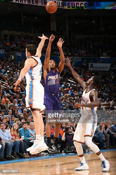 J Warren of the Phoenix Suns takes a shot against the Oklahoma City Thunder on December 14 2014 at Chesapeake Energy Arena in Oklahoma City OK NOTE...