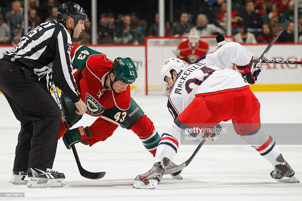 <a gi-track='captionPersonalityLinkClicked' href=/galleries/search?phrase=Warren+Peters&family=editorial&specificpeople=2221807 ng-click='$event.stopPropagation()'>Warren Peters</a> #43 of the Minnesota Wild takes a faceoff against <a gi-track='captionPersonalityLinkClicked' href=/galleries/search?phrase=Derek+MacKenzie&family=editorial&specificpeople=685877 ng-click='$event.stopPropagation()'>Derek MacKenzie</a> #24 of the Columbus Blue Jackets during the game at the Xcel Energy Center on February 11, 2012 in St. Paul, Minnesota.