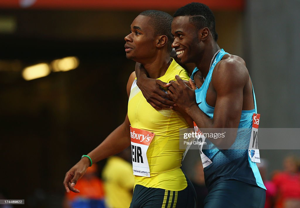 Warren Weir of Jamaica and Jason Young of Jamaica after competing in the Men's 200m on day one during the Sainsbury's Anniversary Games - IAAF Diamond League 2013 at The Queen Elizabeth Olympic Park on July 26, 2013 in London, England.