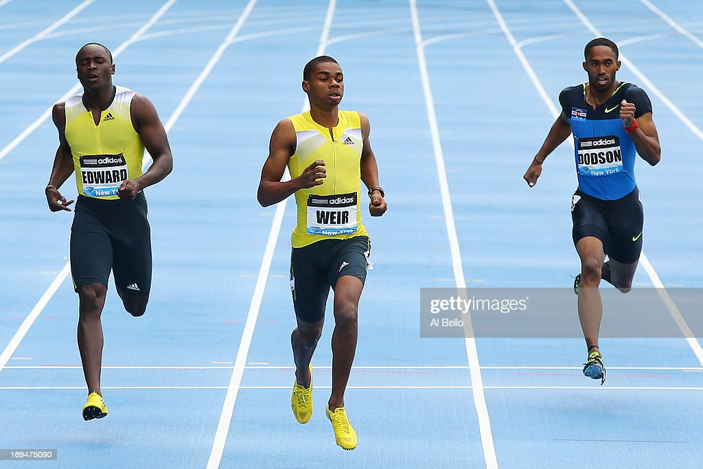 <a gi-track='captionPersonalityLinkClicked' href=/galleries/search?phrase=Warren+Weir&family=editorial&specificpeople=9482526 ng-click='$event.stopPropagation()'>Warren Weir</a> of Jamaica wins the 200 Meter Final with <a gi-track='captionPersonalityLinkClicked' href=/galleries/search?phrase=Alonso+Edward+-+Sprinter&family=editorial&specificpeople=6147378 ng-click='$event.stopPropagation()'>Alonso Edward</a> of Panama (L) and Jeremy Dodson of the USA finishing second and third during the Adidas Grand Prix at Icahn Stadium on Randall's Island on May 25, 2013 in New York City.