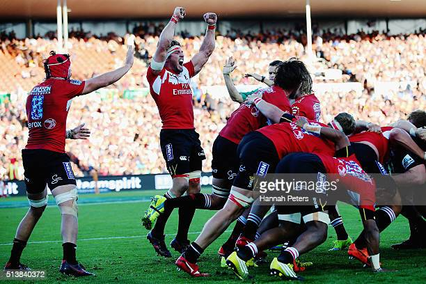 Warren Whiteley of the Lions and Jaco Kriel of the Lions celebrate after winning the round two Super Rugby match between the Chiefs and the Lions at...