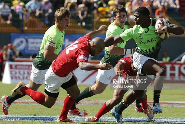 Warrick Gelant of South Africa is tackled by Gaston Revol of Argentina during their quarterfinal rugby match in the Dubai leg of IRB's Sevens World...