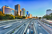 Wide view of multi lane Warringah freeway going through North SYdney during morning rush hour traffic peak and congestion in Australia.