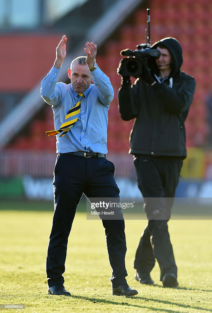 Warrington manager Shaun Reid salutes the Warrington fans at the end of the FA Cup Second Round tie between Gateshead FC v and Warrington Town at the Gateshead International Stadium on December 7, 2014 in Gateshead, England.