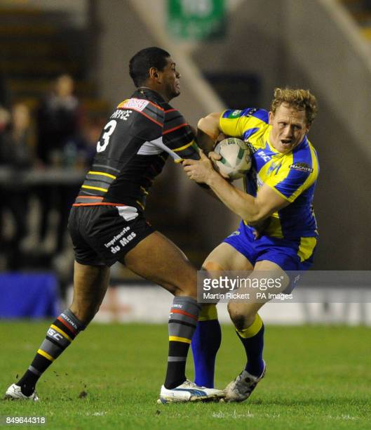 Warrington Wolves' Ben Westwood is tackled by Catalan Dragons Leon Pryce during the Super League match at Halliwell Jones Stadium Warrington
