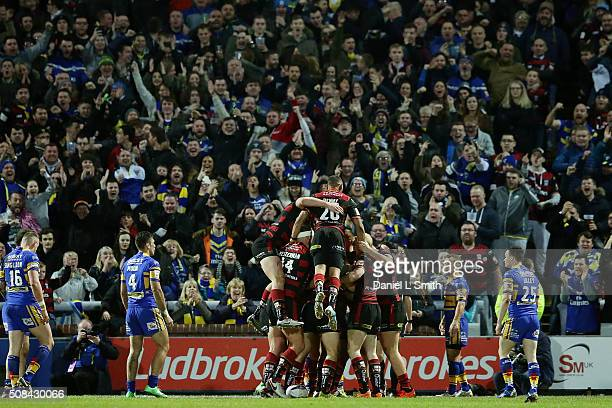 Warrington Wolves celebrate after Chris Sandow scores the opening try of the First Utility Super League opening match between Leeds Rhinos and...