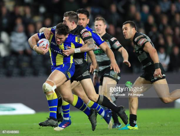Warrington Wolves' Joe Philbin is tackled by Hull FC's Jamie Shaul during the Betfred Super League match at the KCOM Stadium Hull