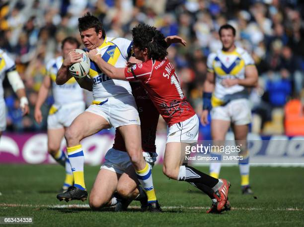 Warrington Wolves' Lee Briers bursts through despite the close attentions of Celtic Crusaders' Matty Smith