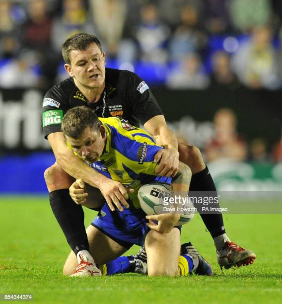 Warrington Wolves' Lee Briers is tackled by Huddersfield Giants' Brett Ferres during the Super League SemiFinal match at The Halliwell Jones Stadium...