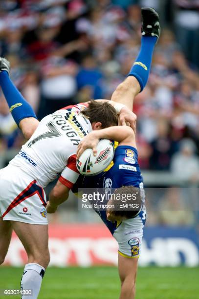 Warrington Wolves' Martin Gleeson is tackled by Wakefield Wildcats' Danny Brough