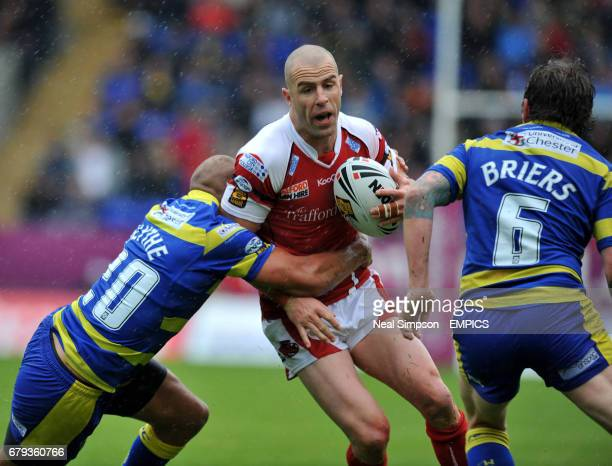Warrington Wolves' Matty Blythe and Lee Briers combine to stop Salford City Reds' Luke Patten