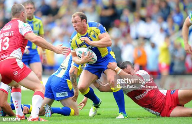 Warrington Wolves' Micky Higham is tackled by Hull Kingston Rovers' Josh Hodgson during the Super League match at the Halliwell Jones Stadium...