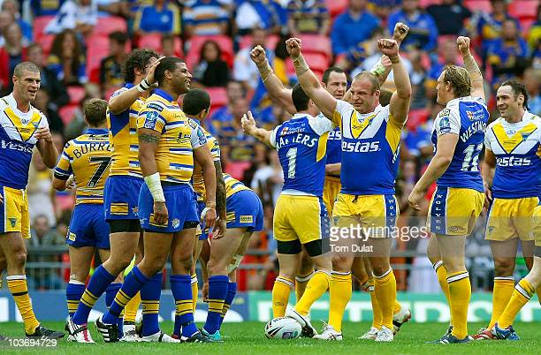 Warrington Wolves players celebrate winning the Carnegie Challenge Cup Final match between Leeds Rhinos and Warrington Wolves at the Wembley Stadium...
