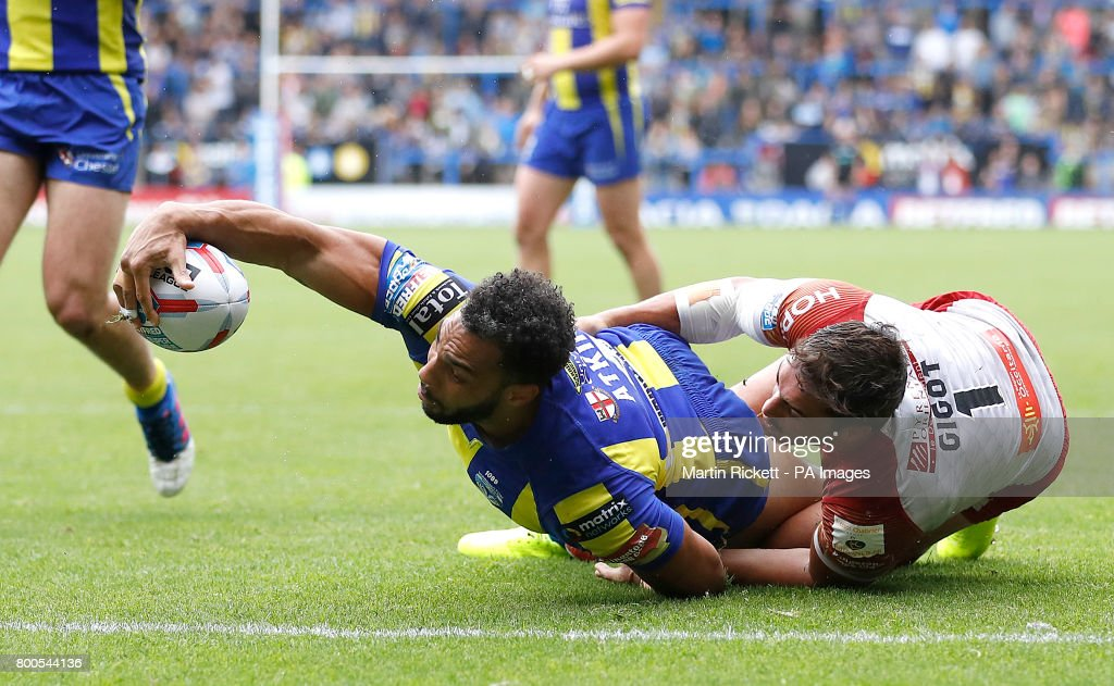 Warrington Wolves' Ryan Atkins goes over for a try past Catalans Dragons' Tony Gigot, during the Betfred Super League match at the Halliwell Jones Stadium, Warrington.