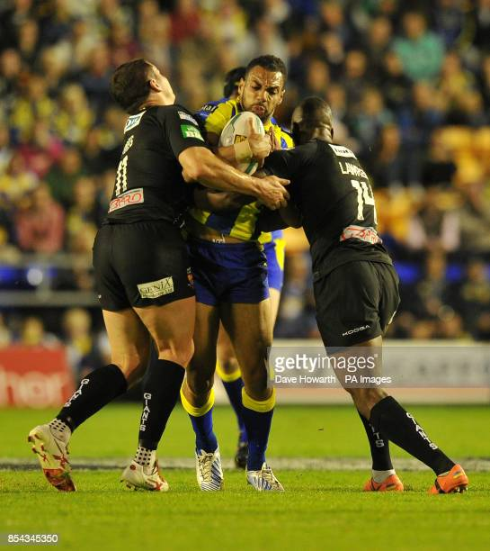 Warrington Wolves' Ryan Atkins is tackled by Huddersfield Giants' Brett Ferres and Michael Lawrence during the Super League SemiFinal match at The...