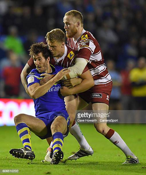 Warrington Wolves' Stefan Ratchford is tackled by Wigan Warriors' Dom Crosby and Ben Evans during the First Utility Super League Super 8s Round 6...