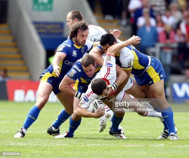 Warrington's Jon Clarke Vinnie Anderson and Paul Rauhihi tackle Hull KR's Chris Chester during the engage Super League match at the Halliwell Jones...