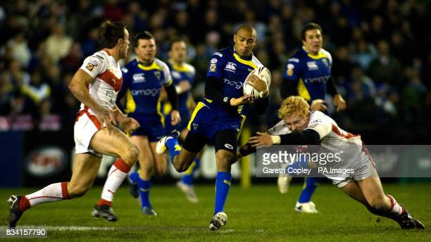 Warrington's Kevin Penny breaks between St Helen's James Roby and James Graham during the engage Super League match at Knowsley Road St Helens
