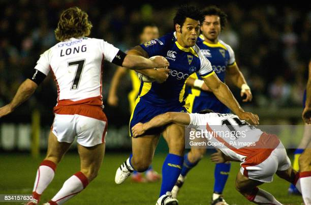 Warrington's Paul Rauhihi breaks between St Helen's Sean Long and James Roby during the engage Super League match at Knowsley Road St Helens