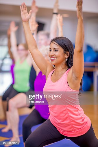 Warrior 1 Pose in Yoga Class