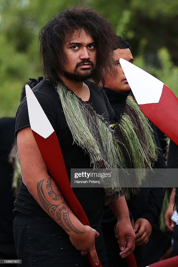 A warrior arrives after bringing King Tuheitia in a waka to the Waahi marae on October 8, 2012 in Huntly, New Zealand. King Tuheitia marked the anniversary of his grandfather's coronation with a waka taua journey from Ngaaruawaahia to Waahi marae.