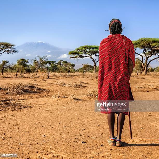 Warrior from Maasai tribe looking at Mount Kilimanjaro, Kenya, Africa