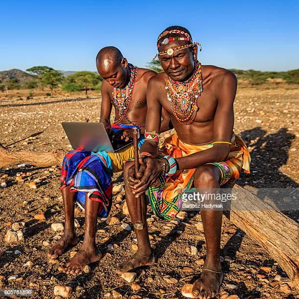 Warrior from Samburu tribe using laptop, Kenya, Africa