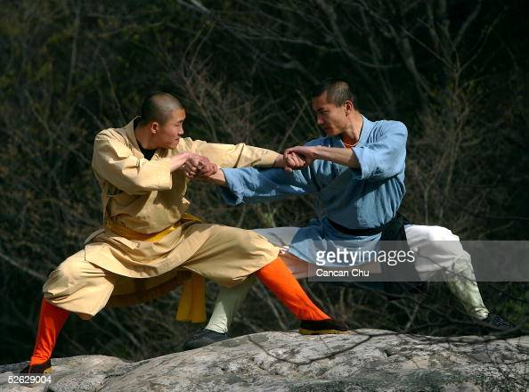 Warrior monks of the Shaolin Temple display their Kung Fu skills at the Songshan Mountain near the temple April 12 2005 in Dengfeng Henan Province...