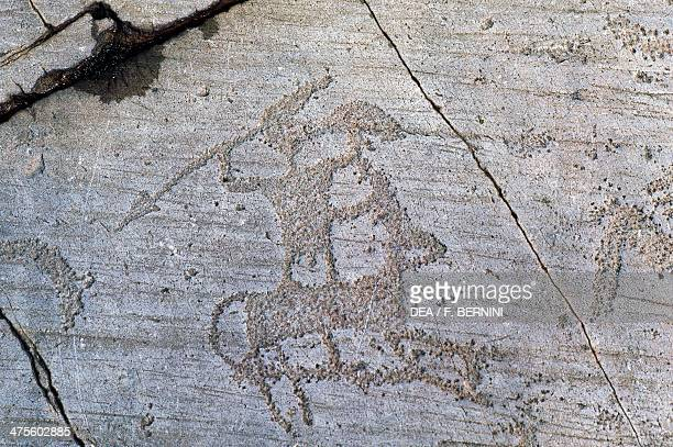 Warrior rock carvings in Val Camonica Lombardy Italy 5th1st millennium BC