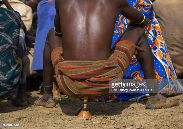 Warrior sit on his wooden seat during the proud ox ceremony in Dassanech tribe Turkana County Omorate Ethiopia on June 6 2017 in Omorate Ethiopia