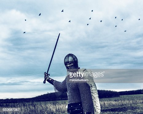 Warrior with helmet and sword ready to attack