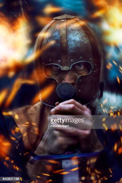 Warrior with helmet surrounded by flames