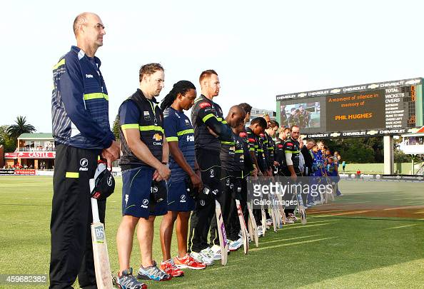 Warriors and Cobras pause for a moment of silence in memory of Phil Hughes during the Ram Slam T20 Challenge match between Chevrolet Warriors and...