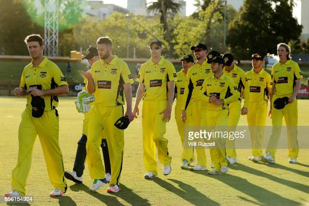 Warriors captain Mitchell Marsh leads the team off the field after defeating the Bushrangers during the JLT One Day Cup match between Victoria and...
