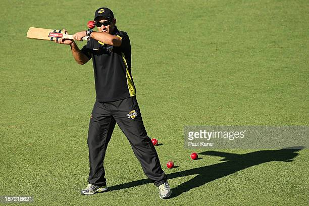 Warriors coach Justin Langer hits balls for catching practice at the change of innings during day two of the Sheffield Shield match between the...