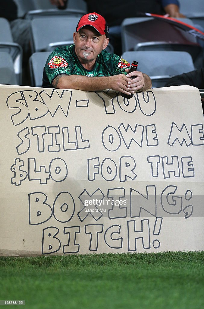 A Warriors fan displays an anti Sonny Bill Williams banner during the round two NRL match between the New Zealand Warriors and the Sydney Roosters at Eden Park on March 16, 2013 in Auckland, New Zealand.