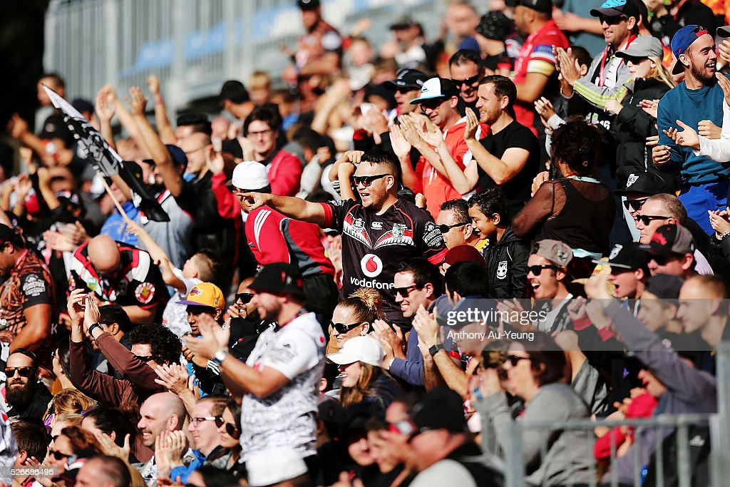 Warriors fans cheer on their team during the round nine NRL match between the New Zealand Warriors and the St George Illawarra Dragons at Mt Smart Stadium on May 1, 2016 in Auckland, New Zealand.