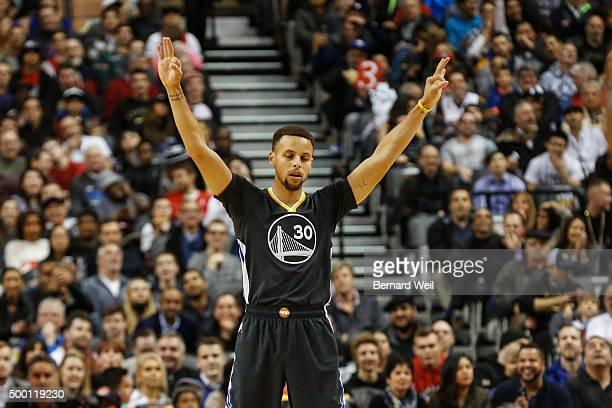Warriors' guard Stephen Curry gestures to the team during 1st half action against Toronto Raptors in NBA regular season action at Air Canada Centre...