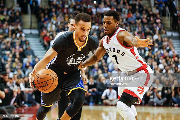 Warriors' guard Stephen Curry gets past Raptors' guard Kyle Lowry in 1st half action Toronto Raptors vs Golden State Warriors in NBA regular season...