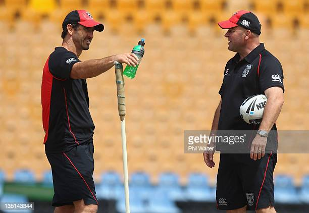 Warriors Head Coach Brian McClennan talks with skills coach Andrew Johns during a New Zealand Warriors media session at Mt Smart Stadium on December...