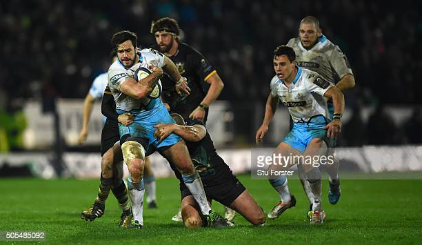 Warriors player Alex Dunbar makes a break during the European Rugby Champions Cup match between Northampton Saints and Glasgow Warriors at Franklin's...