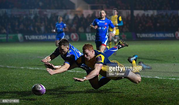 Warriors player Connor Braid dives to score the opening try during the European Rugby Challenge Cup match between Newport Gwent Dragons and Worcester...